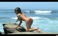 Melanie Iglesias in a bikini - ass