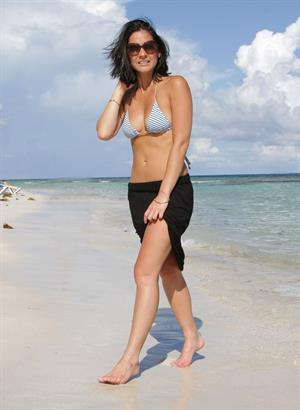 Olivia Munn on the beach