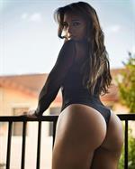 Ashley Ortiz in a bikini - ass