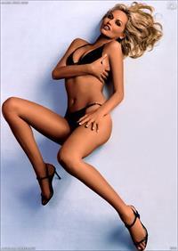 Adriana Karembeu in a bikini