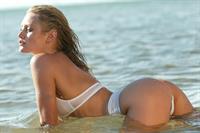 Nicky Whelan in a bikini - ass