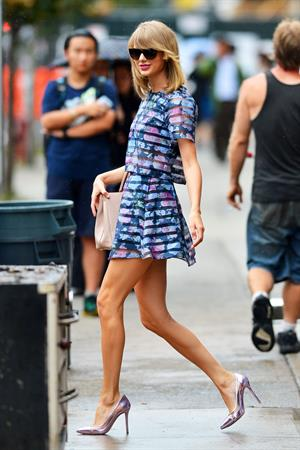Taylor Swift takes a walk in high heels and skirt through New York City August 12, 2014