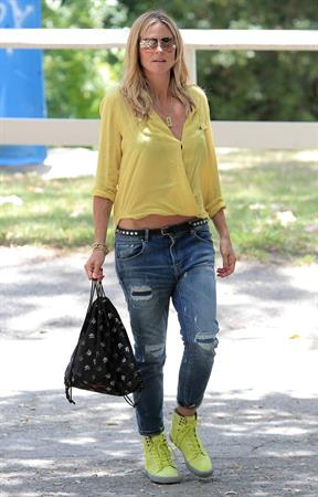 Heidi Klum out for lunch in Brentwood in a yellow shirt