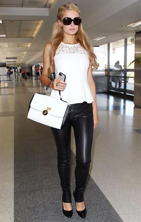 Paris Hilton Arrives at LAAirport in Los Angeles (September 6, 2013)