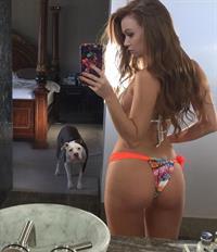 Leanna Decker in a bikini taking a selfie