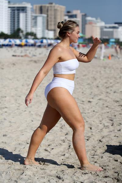 Iskra Lawrence in a swimsuit on Miami beach doing a photoshoot for Aerie on 11/26/2018