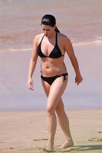 Neve Campbell in a bikini