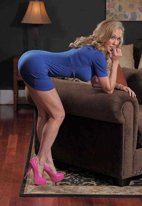tight blue dress hairdresser takes care of her clients  143011