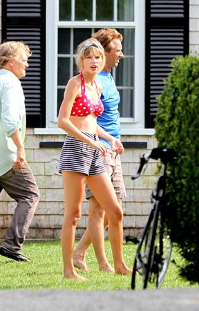 Taylor Swift wearing a bikini top and swimsuit in Hyannis on April 12, 2013