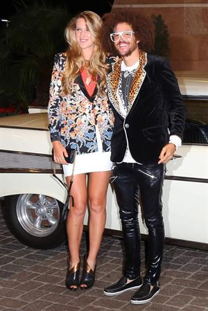 Victoria Azarenka and LMFAO Singer Redfoo arrive for a Player's Party at the IW Club March 7, 2013