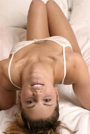 Sara Sexton takes off see through white lingerie